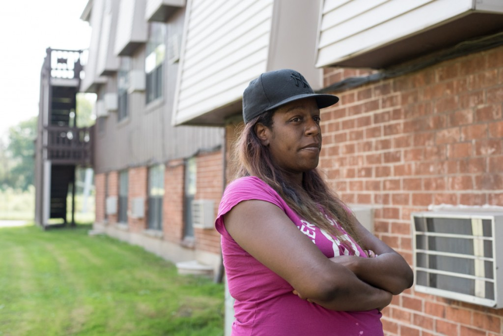 Sheena Godfrey stands outside her home at the Concordia Place Apartments in Riverdale. (Photo by Max Herman)